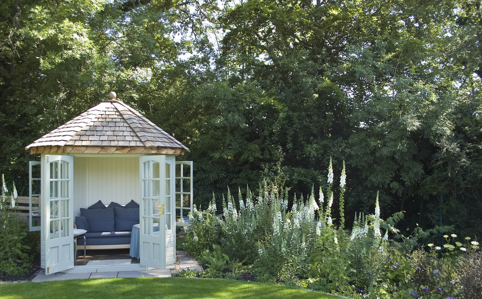 Inviting summerhouse at the woodland's edge
